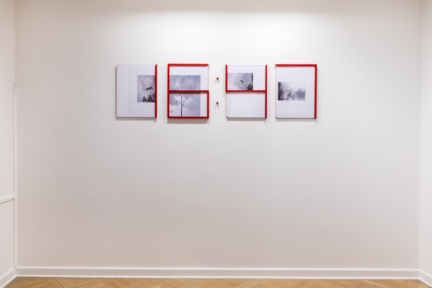 """The installation """"Sistema en tiempo real"""" by the artist Adriana Lara is a four-part collage series whose framings cut through the images to visualize numbers in a time display. The numbers in the piece make palpable ideas of interactivity in our perception of time."""